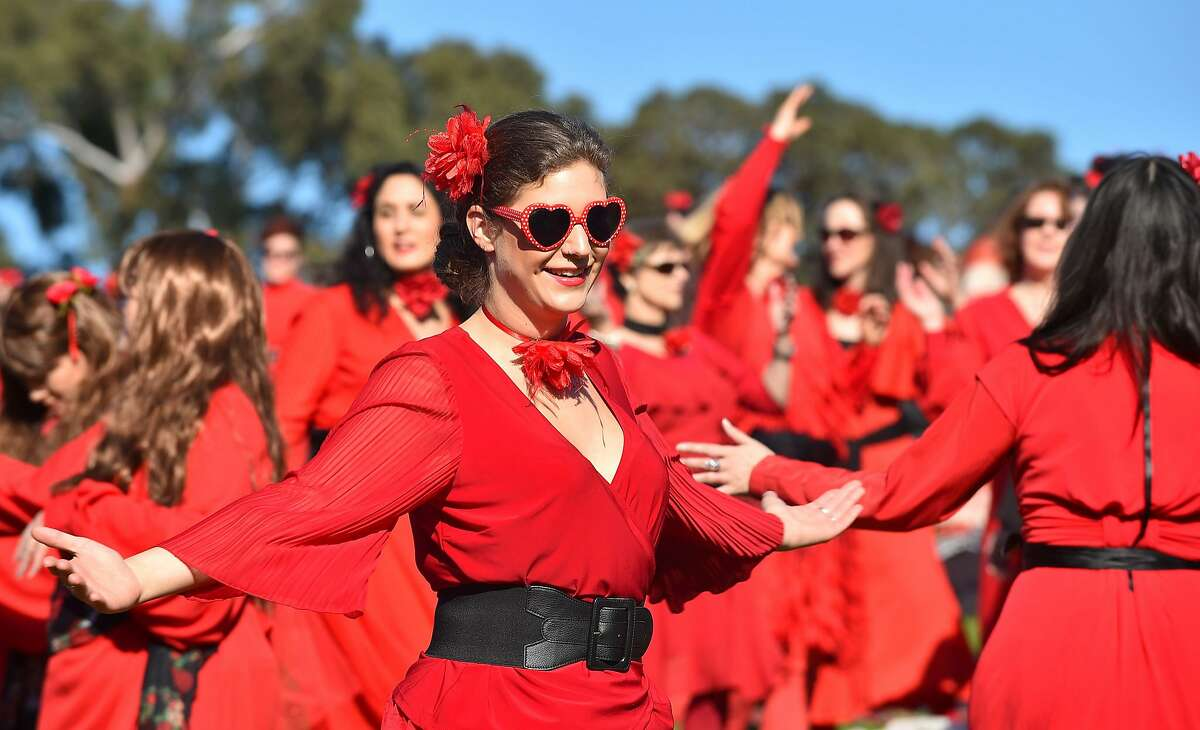 Kate Bush fans rehearse a dance before performing during a celebration to mark 'The Most Wuthering Heights Day Ever' in Melbourne on July 16, 2016. Thousands of Kate Bush fans put on their best billowy red dresses and danced en masse in Melbourne on July 14 to one of the singer's most iconic songs Wuthering Heights. / AFP PHOTO / Paul CrockPAUL CROCK/AFP/Getty Images