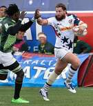 LAS VEGAS, NV - MARCH 06: Danny Barrett (R) of the United States holds off Tim Agaba of South Africa during the USA Sevens Rugby tournament at Sam Boyd Stadium on March 6, 2016 in Las Vegas, Nevada. South Africa won 21-10. (Photo by David Becker/Getty Images)