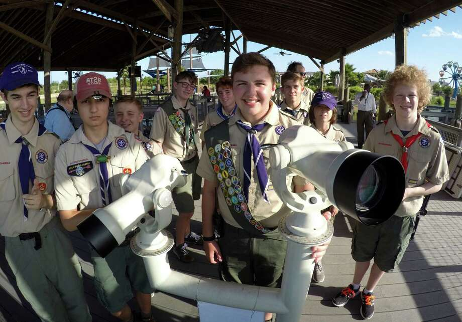 Eagle Scout Kyle Klose, front right, and fellow scouts of Troop 2010 stand by a set of telescopes designed to be accessible by people in wheelchairs at Morgan's Wonderland on Thursday, July 14, 2016. Klose raised over $7,000 to pay for the scopes and installation. Photo: Billy Calzada, Staff / San Antonio Express-News / San Antonio Express-News