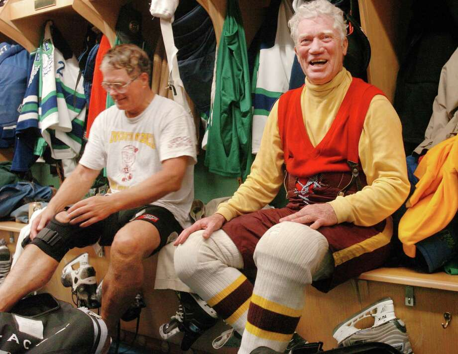 FILE - In this  Jan. 16, 2005, file photo, former Minnesota Gov. Wendell Anderson, right, and Larry Stordahl strip off their gear after an hour of senior hockey at Blake Arena in Hopkins, Minn. Anderson, a former U.S. Olympian who was described in a 1973 Time magazine cover article as the youthful embodiment of his home state only to lose public confidence later by arranging his own appointment to the U.S. Senate, died Sunday, July 17, 2016. He was 83.  (Chris Polydoroff/Pioneer Press via AP, File) Photo: Chris Polydoroff, MBO / AP2005