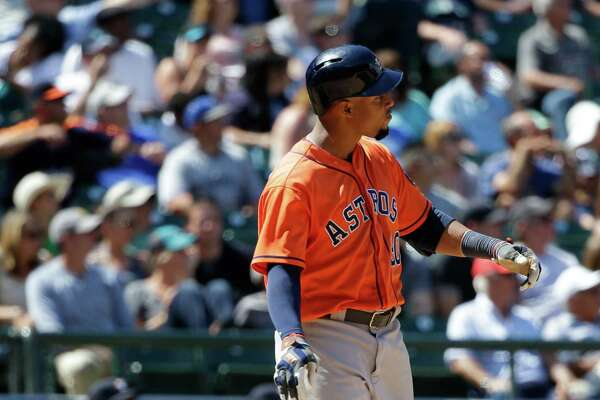 Houston Astros' Carlos Gomez drops his bat and watches his grand slam in the seventh inning of a baseball game against the Seattle Mariners, Sunday, July 17, 2016, in Seattle. (AP Photo/Ted S. Warren)
