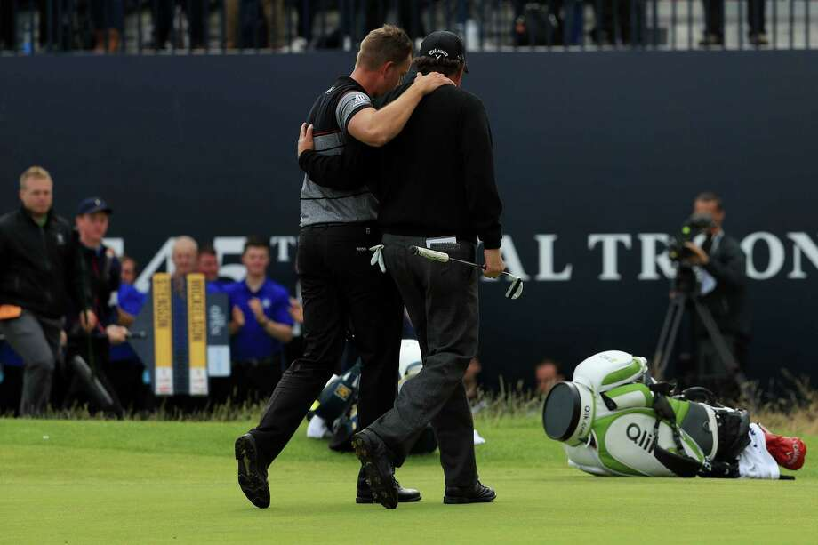 Henrik Stenson, left, and Phil Mickelson leave the 18th green after providing one of the most dramatic one-on-one duels in major championship history. Photo: Mike Ehrmann, Staff / 2016 Getty Images