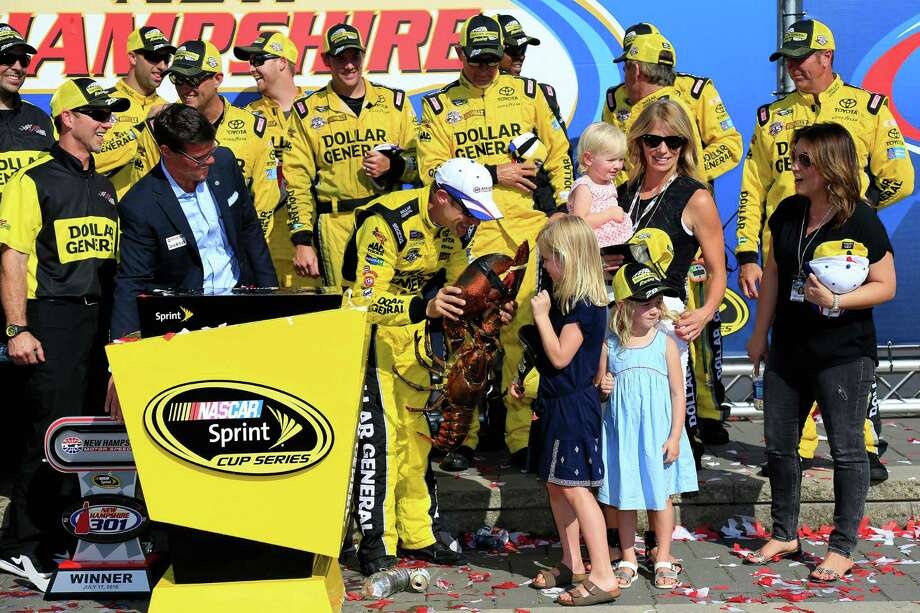 "One of Matt Kenseth's daughters is apprehensive about the ""trophy"" that accompanied her father's victory Sunday in New Hampshire. Photo: Chris Trotman, Stringer / 2016 Getty Images"