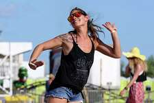 Float Fest employee Allison Bee Levy dances  while on a break during Float Fest held at Cool River Ranch Sunday July 17, 2016 in Martindale, Tx.