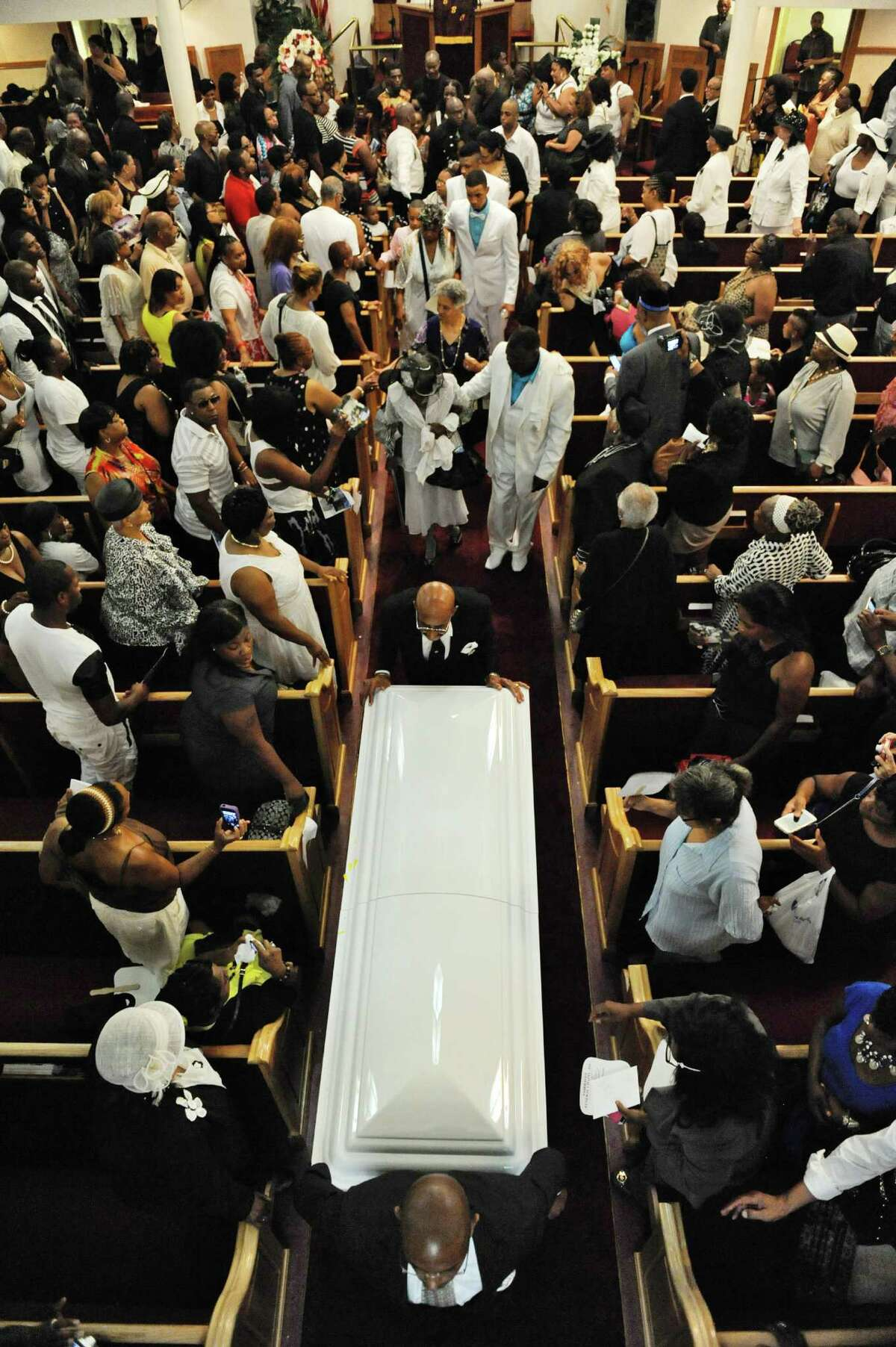 FILE - In this July 23, 2014 file photo, the casket of Eric Garner is taken from Beth Baptist Church in the Brooklyn borough of New York. Two years after the police chokehold death of Garner made