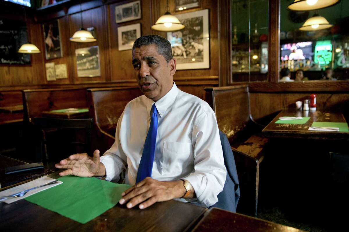 In this Wednesday, July 6, 2016 photo, Adriano Espaillat gestures as he speaks during an interview with The Associated Press in New York. In an election year filled with debate over immigration, Espaillat hopes his personal story makes its own statement. After living at one point in the country without documentation, he could become the first Dominican-American in Congress. (AP Photo/Mary Altaffer) ORG XMIT: NYMA302