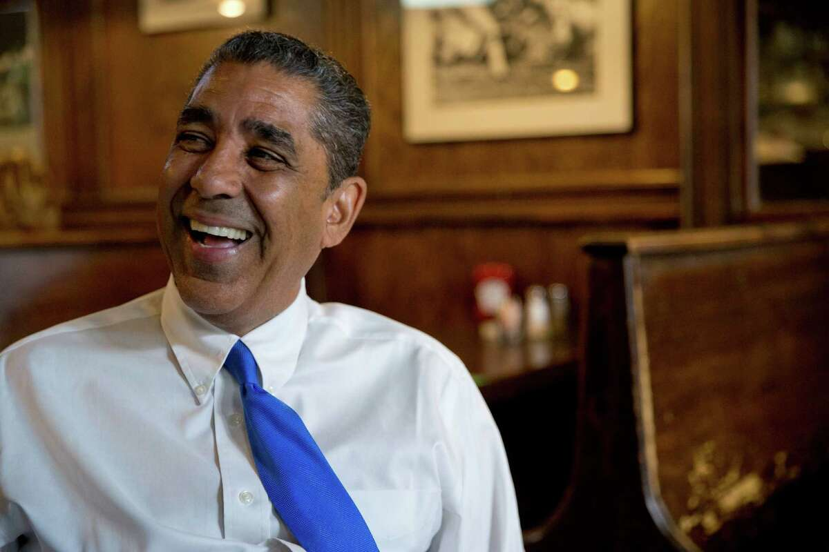 In this Wednesday, July 6, 2016 photo, Adriano Espaillat smiles during an interview with The Associated Press in New York. In an election year filled with debate over immigration, Espaillat hopes his personal story makes its own statement. After living at one point in the country without documentation, he could become the first Dominican-American in Congress. (AP Photo/Mary Altaffer) ORG XMIT: NYMA304