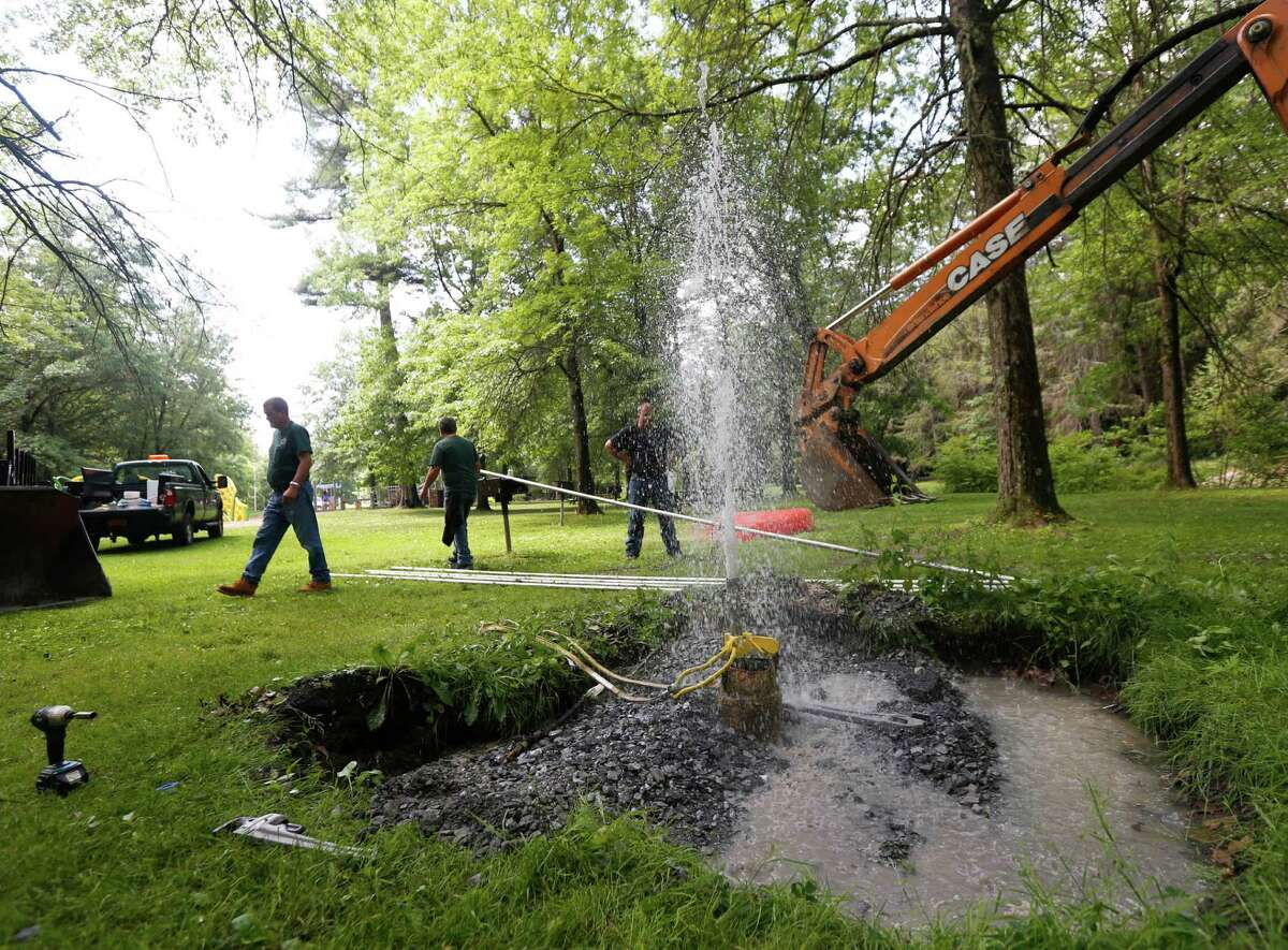 In this Wednesday, June 29, 2016 photo, water spouts from Shonts Well # 3 that is being in restored at Saratoga Spa State Park in Saratoga Springs, N.Y. Members of a parks support group are restoring the long-lost mineral spring in this upstate city known for its waters. The spring was capped decades ago after being among the most popular of the mineral springs that made Saratoga Springs the nation's first resort town. (AP Photo/Mike Groll) ORG XMIT: NYMG201