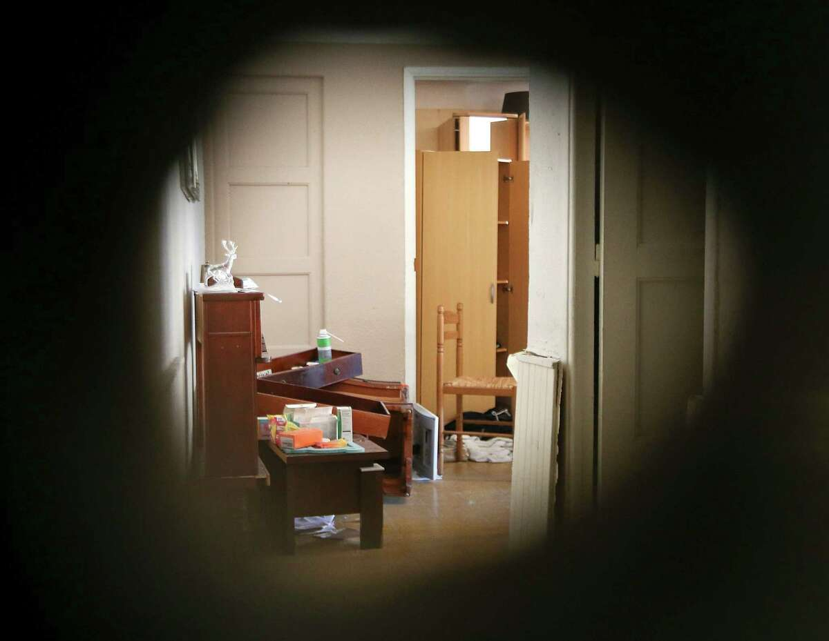 The apartment of Mohamed Lahouaiej Bouhlel is photographed through a hole in the wall made by police, in Nice, southern France, Saturday, July 16, 2016. The man responsible for turning a night of celebration into one of carnage in the seaside city of Nice was a petty criminal who hadn't been on the radar of French intelligence services before the attack. (AP Photo/Luca Bruno) ORG XMIT: XNIC115