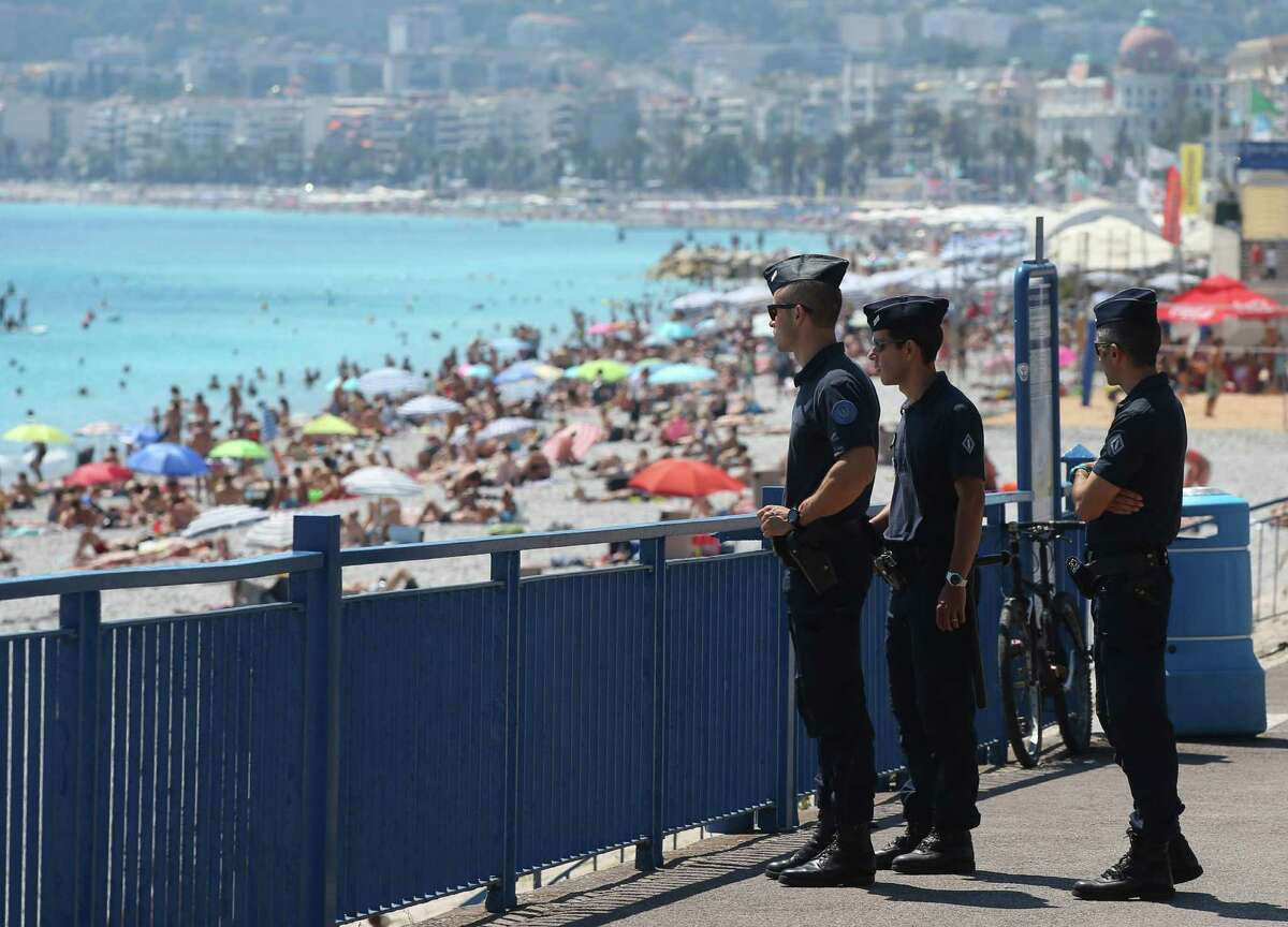 French police officers patrol on the famed Promenade des Anglais in Nice, southern France, three days after a truck mowed through revelers, Sunday, July 17, 2016. French authorities detained two more people Sunday in the investigation into the Bastille Day truck attack on the Mediterranean city of Nice that killed at least 84 people, as authorities try to determine whether the slain attacker was a committed religious extremist or just a very angry man. (AP Photo/Luca Bruno) ORG XMIT: REB121