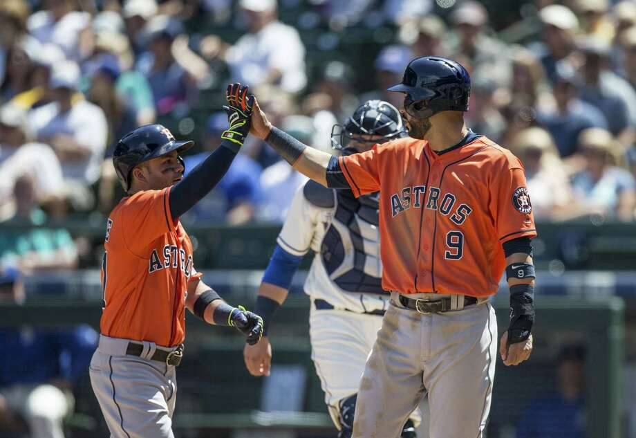 Jose Altuve, left, earns a high-five from Marwin Gonzalez after hitting a two-run homer to put the Astros up by three runs Sunday. Photo: Stephen Brashear, Stringer / 2016 Getty Images