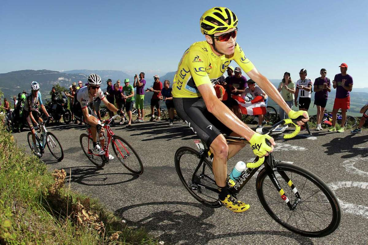 CULOZ, FRANCE - JULY 17: Christopher Froome of Great Britain riding for Team Sky in the yellow leader's jersey rides in the peloton up the Lacets du Grand Colombier during stage fifteen of the 2016 Le Tour de France, a 160km stage from Bourg-En Bresse to Culoz on July 17, 2016 in Culoz, France. (Photo by Chris Graythen/Getty Images) ORG XMIT: 645214265