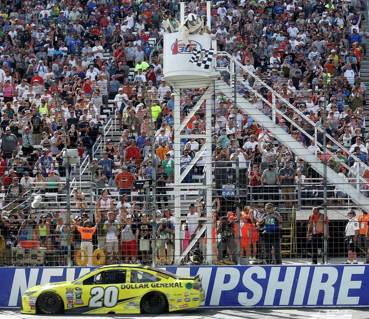 NASCAR driver Matt Kenseth gets the checkered flag to win the New Hampshire 301 auto race at New Hampshire Motor Speedway Sunday, July 17, 2016, in Loudon, N.H. (AP Photo/Jim Cole) ORG XMIT: NHJC110