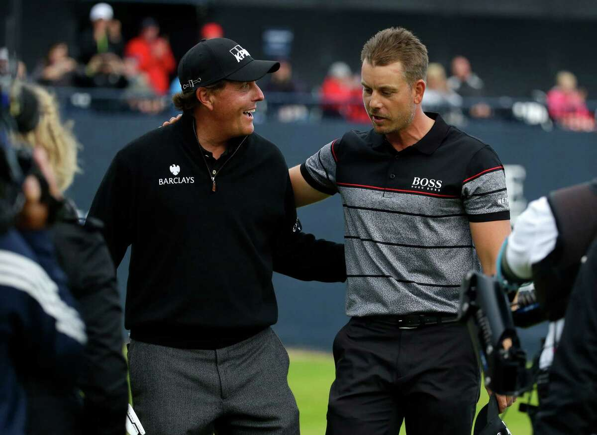 Phil Mickelson of the United States, left congratulates Henrik Stenson of Sweden for winning the British Open Golf Championships at the Royal Troon Golf Club in Troon, Scotland, Sunday, July 17, 2016. (AP Photo/Matt Dunham) ORG XMIT: XAG345