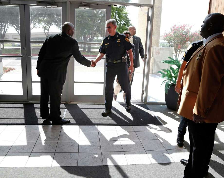 Police Commissioner William McNamus is greeted before his appearance at community forum at New Creation Fellowship Church on Sunday, July 17, 2016. Photo: Ron Cortes, Freelance / For The San Antonio Express-News