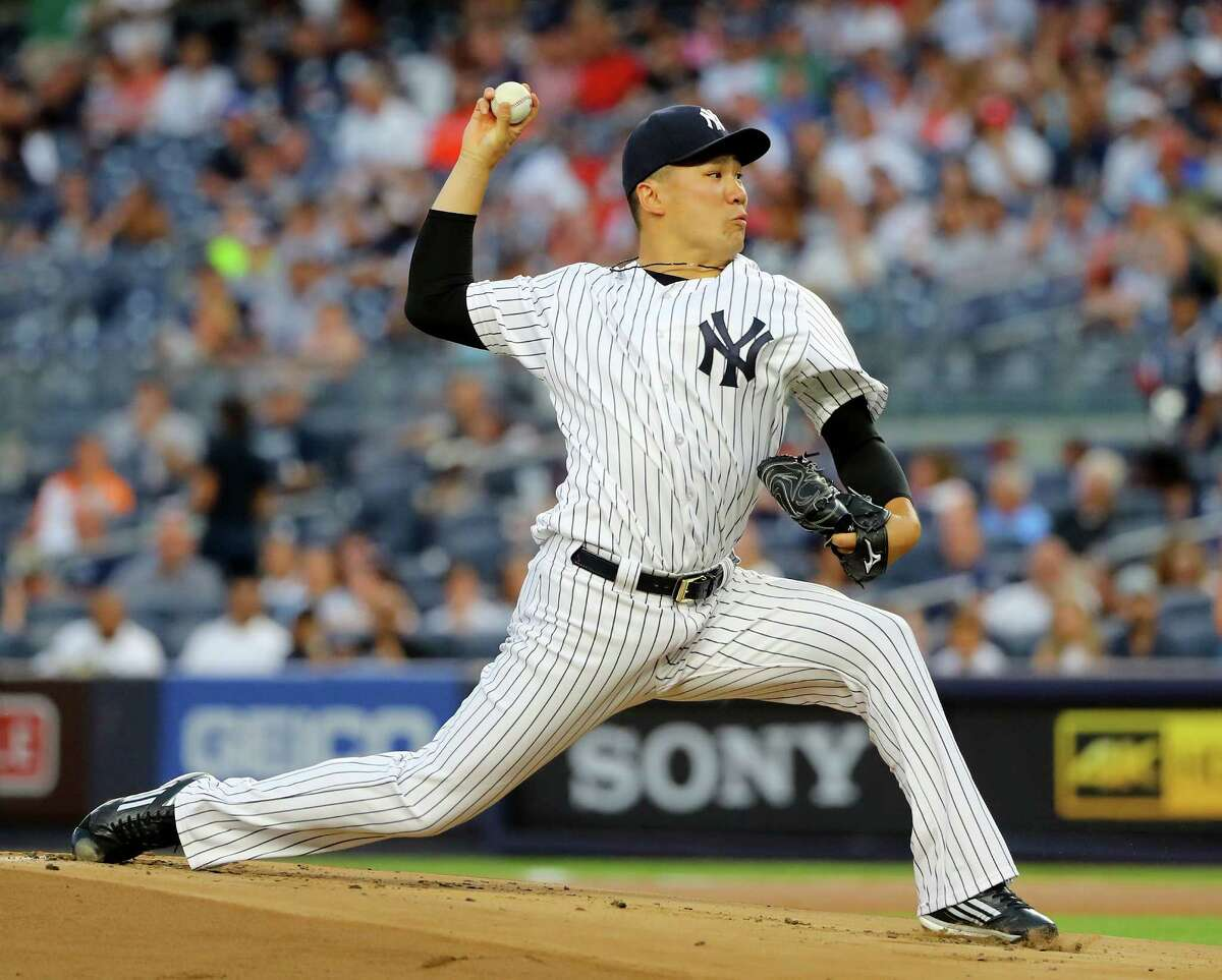 NEW YORK, NY - JULY 17: Masahiro Tanaka #19 of the New York Yankees delivers a pitch in the first inning against the Boston Red Sox at Yankee Stadium on July 17, 2016 in the Bronx borough of New York City. (Photo by Elsa/Getty Images) ORG XMIT: 607681823
