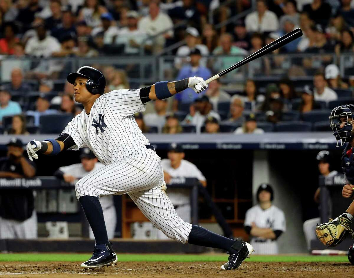 NEW YORK, NY - JULY 17: Starlin Castro #14 of the New York Yankees drives in a run in the fourth inning against the Boston Red Sox at Yankee Stadium on July 17, 2016 in the Bronx borough of New York City. (Photo by Elsa/Getty Images) ORG XMIT: 607681823