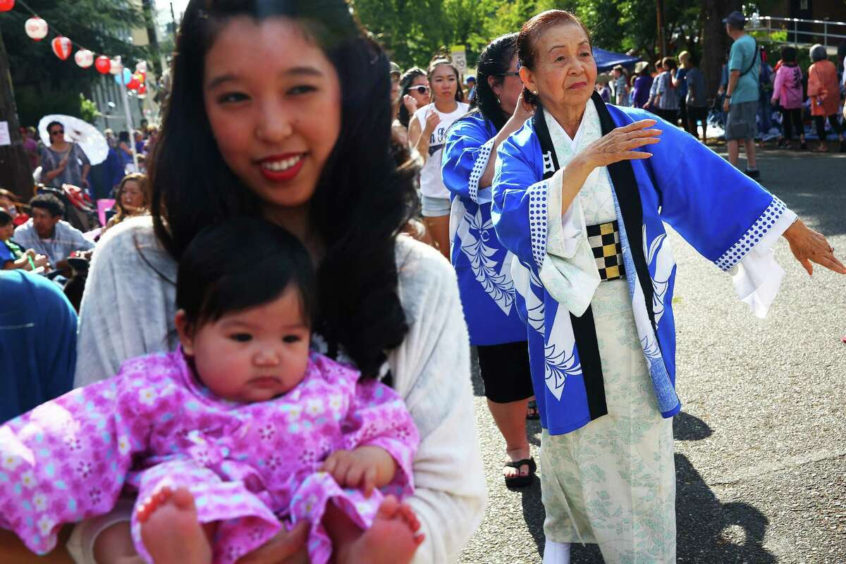 Linda Zee, right, dances during the annual Bon Odori festival, Sunday, July 17, 2016 at the Seattle Buddhist Church.