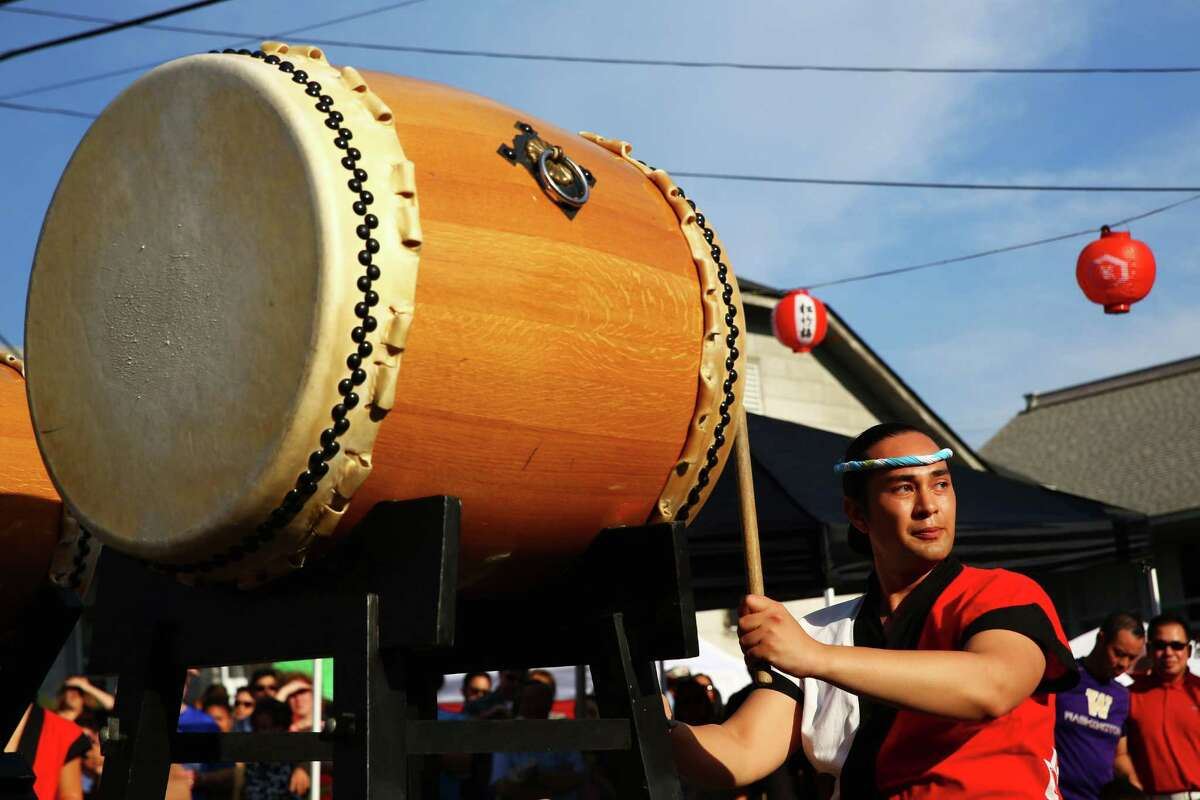 Stephen Soule drums with Seattle Matsuri Taiko during the annual Bon Odori festival, Sunday, July 17, 2016 at the Seattle Buddhist Church.