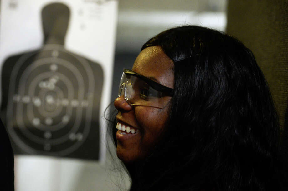 Shameka Peacock checks out her target while practicing her shooting at the Lone Star Indoor Gun Range on Friday afternoon.  Photo taken Friday 7/15/16 Ryan Pelham/The Enterprise Photo: Ryan Pelham / ©2016 The Beaumont Enterprise/Ryan Pelham