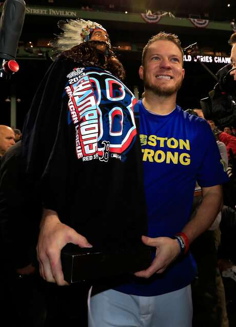 Jake Peavy, shown celebrating the Red Sox's title in 2013, says he still gets chills thinking about the connection between the team and Boston's citizens. Photo: Jamie Squire, Getty Images