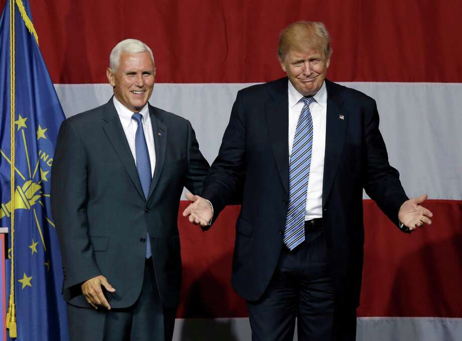 Indiana Gov. Mike Pence joins Republican presidential candidate Donald Trump at a rally in Westfield, Ind., Tuesday, July 12, 2016. (AP Photo/Michael Conroy) Photo: Michael Conroy, STF / Copyright 2016 The Associated Press. All rights reserved. This material may not be published, broadcast, rewritten or redistribu