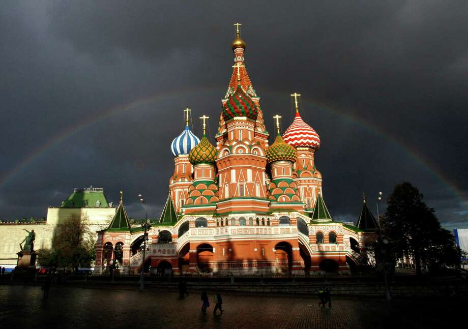 St. Basil Cathedral looms over Red Square in Moscow, where new anti-terrorism measures require require a permit to engage in proselytizing. Photo: ALEXANDER ZEMLIANICHENKO, STF / AP