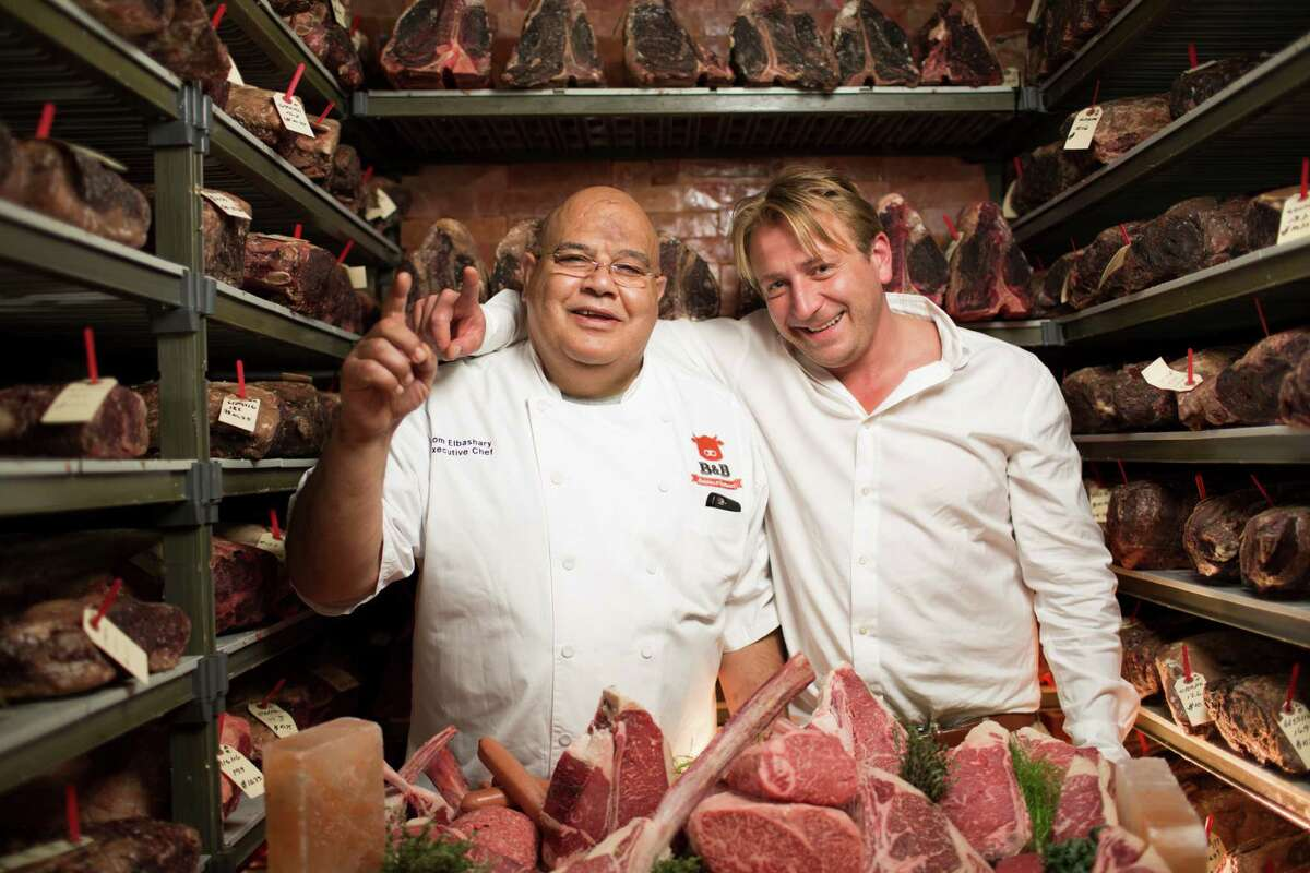 B& Butchers & Restaurant in Houston is one of only nine U.S. licensed restaurants to receive certification by the Kobe Beef Association of Japan. Shown: Executive chef Tommy Elbashary and proprietor Benjamin Berg in the restaurant's dry-aging room.
