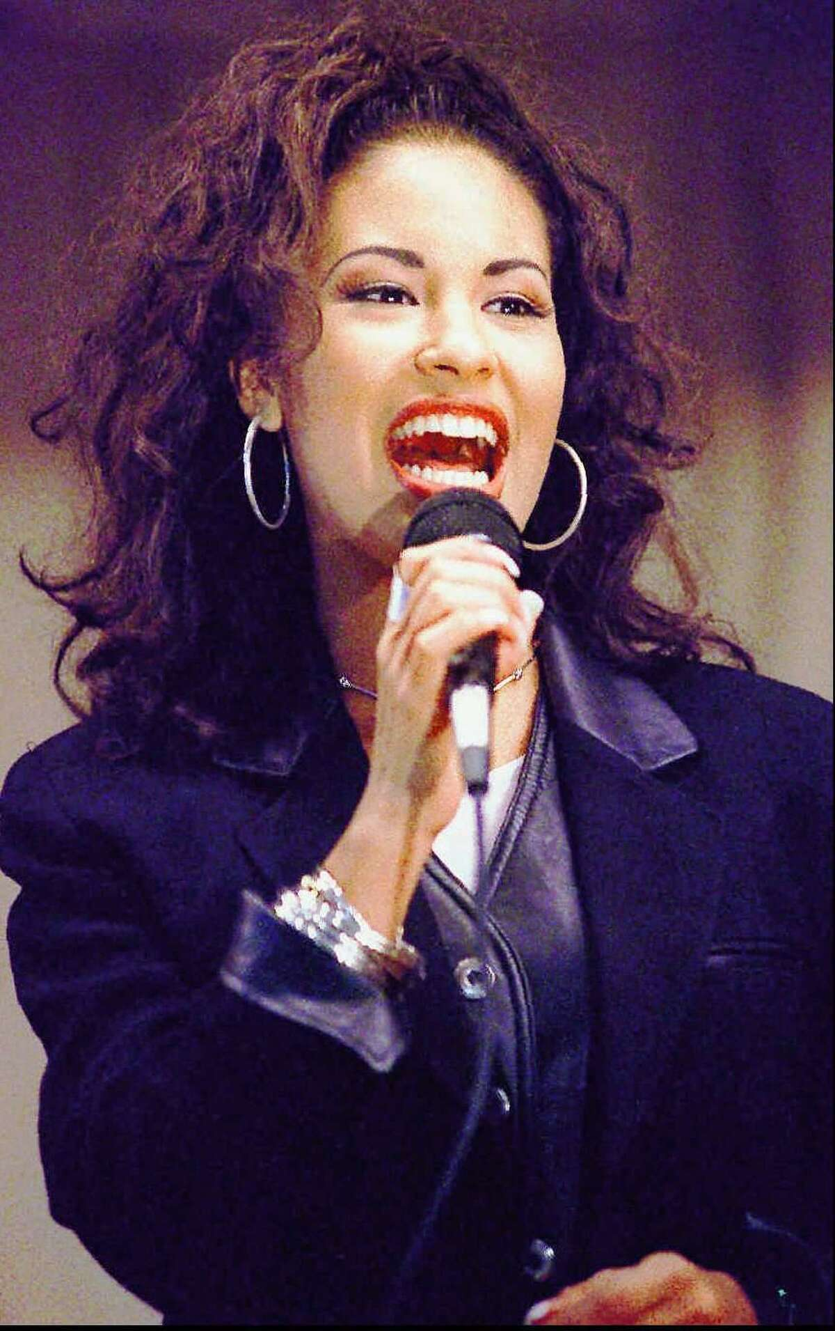 Tejano singer Selena Quintanilla-Perez sings at the Cunningham Elementary School in Corpus Christi Nov. 14, 1994.