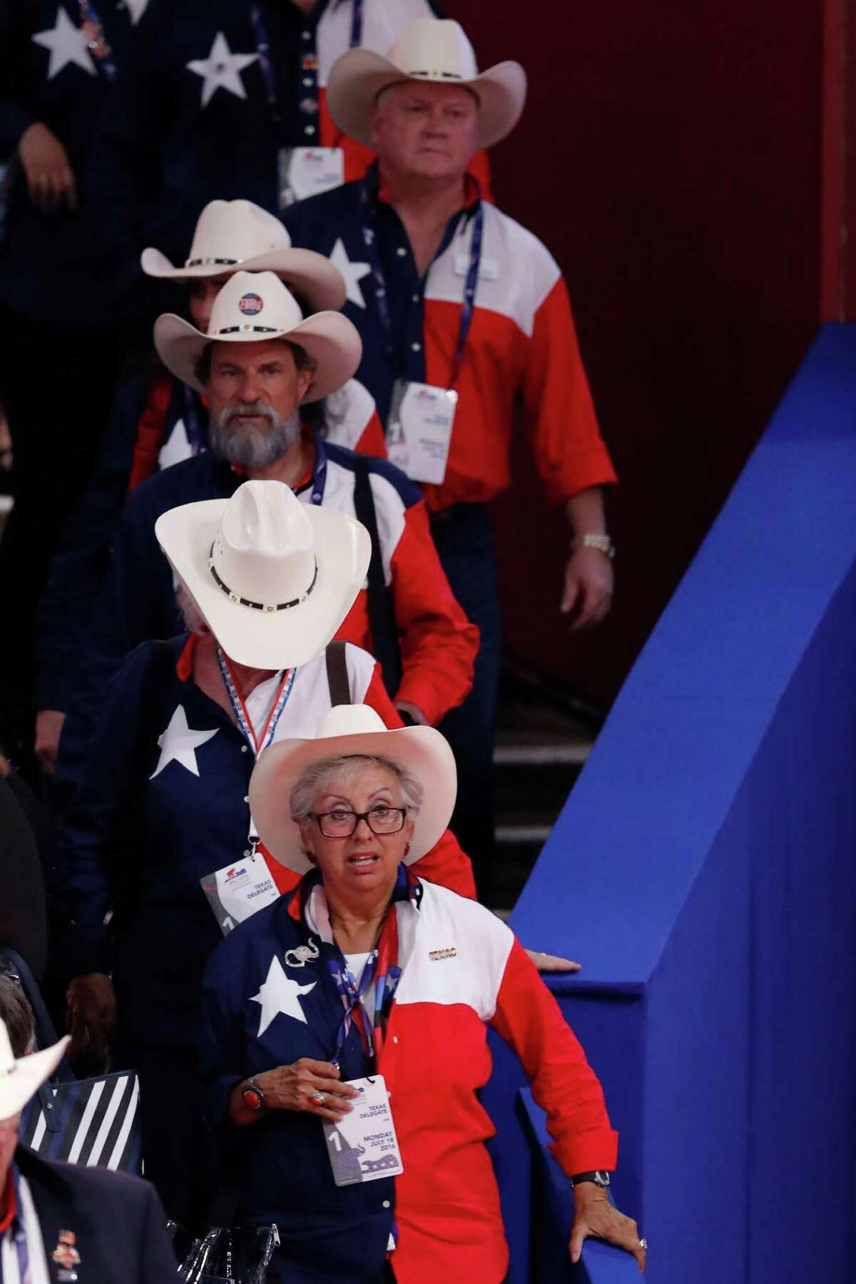 Members of the Texas delegation arrive for opening day of the the Republican National Convention in Cleveland, Monday, July 18, 2016.
