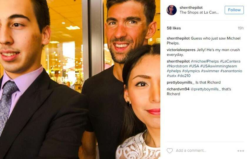 Instagram user @sherrthepilot snapped this photo with Michael Phelps while shopping at La Cantera.