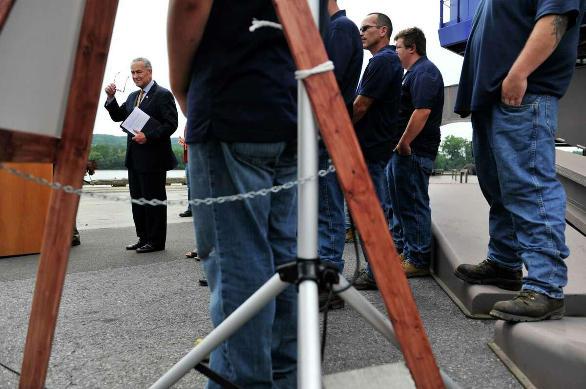 Senator Charles Schumer, surrounded by workers at the Port of Albany, gets set to talk about his work to try and secure $18 million in Federal funds to help make improvements at the port during a press event on Monday, July 18, 2016, in Albany, N.Y. (Paul Buckowski / Times Union)