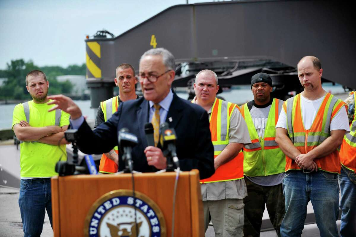 Members of the International Longshoremen's Association, locals 1518 and 1294, listen as Senator Charles Schumer, talks about his work to try and secure $18 million in Federal funds to help make improvements at the Port of Albany during a press event on Monday, July 18, 2016, in Albany, N.Y. (Paul Buckowski / Times Union)