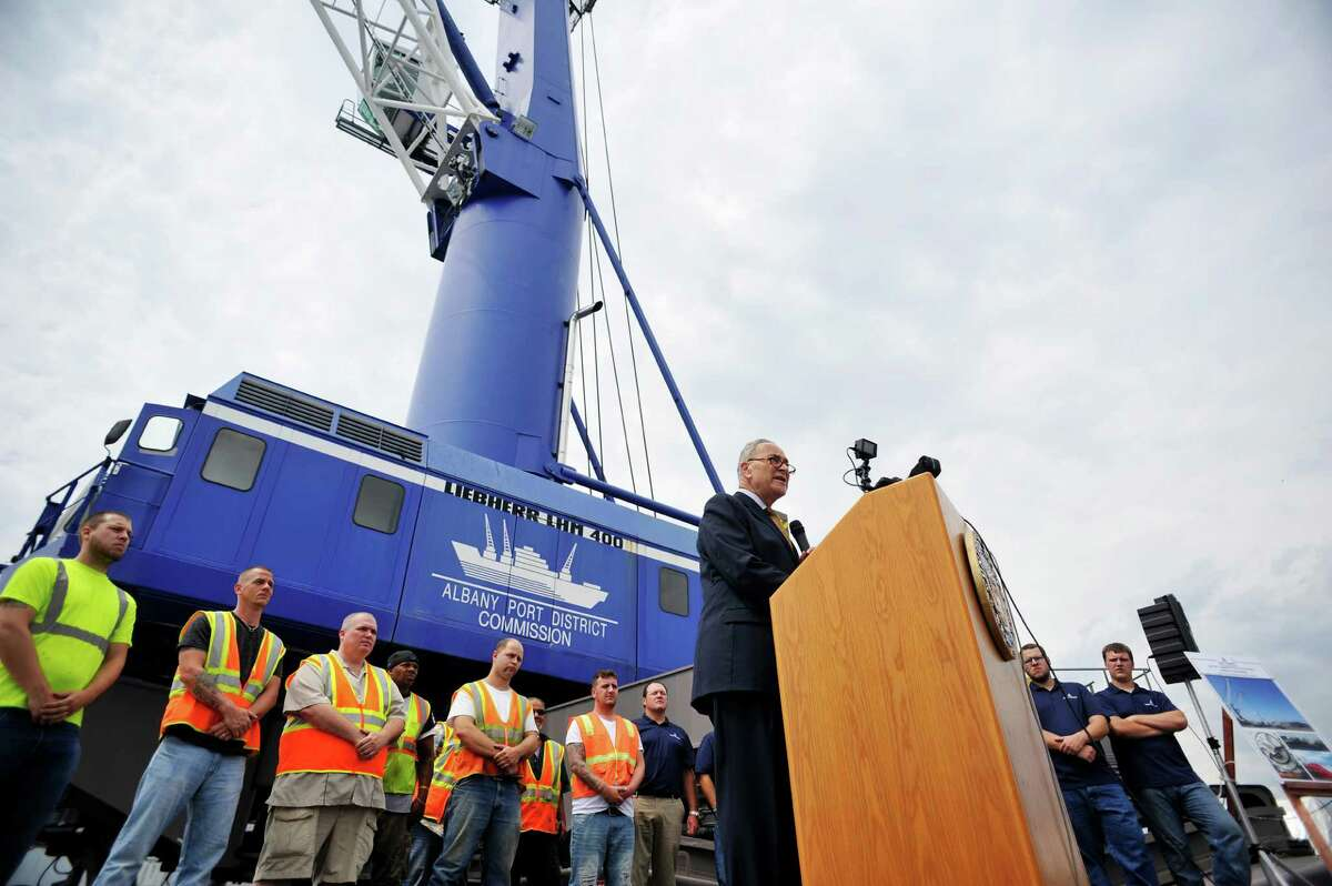 Senator Charles Schumer, surrounded by workers at the Port of Albany, talks about his work to try and secure $18 million in Federal funds to help make improvements at the port during a press event on Monday, July 18, 2016, in Albany, N.Y. (Paul Buckowski / Times Union)