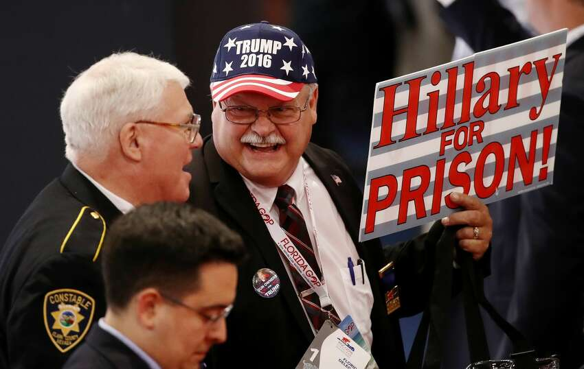 A delegate holds a sign that reads