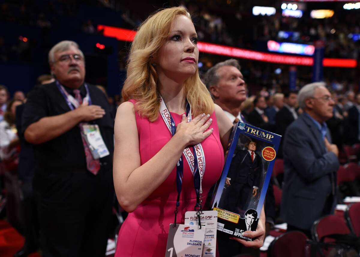 Florida delegate Dana Dougherty holds a Donald Trump doll on the first day of the Republican National Convention on July 18, 2016 at the Quicken Loans Arena in Cleveland, Ohio. The Republican Party opened its national convention Monday, kicking off a four-day political jamboree that will anoint billionaire Donald Trump as the Republican presidential nominee. / AFP / TIMOTHY A. CLARY (Photo credit should read TIMOTHY A. CLARY/AFP/Getty Images)