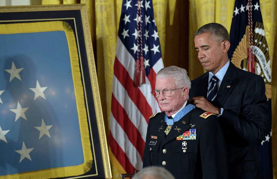 President Barack Obama presents the Medal of Honor to retired Army Lt. Col. Charles Kettles of Michigan during a ceremony in the East Room of the White House in Washington, Monday, July 18, 2016. Kettles distinguished himself in combat operations near Duc Pho, Vietnam, and is credited with saving the lives of 40 soldiers and four of his own crew members. (AP Photo/Susan Walsh) Photo: Susan Walsh, STF / Associated Press / Copyright 2016 The Associated Press. All rights reserved. This material may not be published, broadcast, rewritten or redistribu