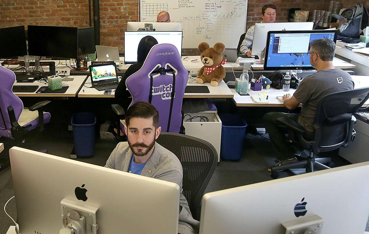 Twitch product marketing manager Brian Petrocelli watches Twitch at his desk at their headquarters on Monday, July 18, 2016, in San Francisco, Calif.