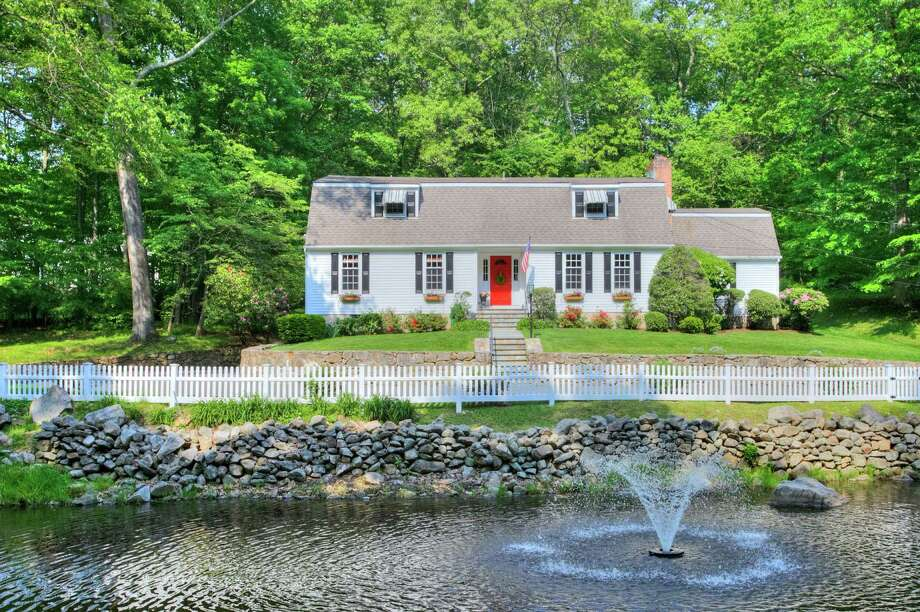 This New Canaan house located on Bittersweet Lane is on the market for $1,295,000. Photo: Contributed Photo / Contributed Photo / New Canaan News freelance