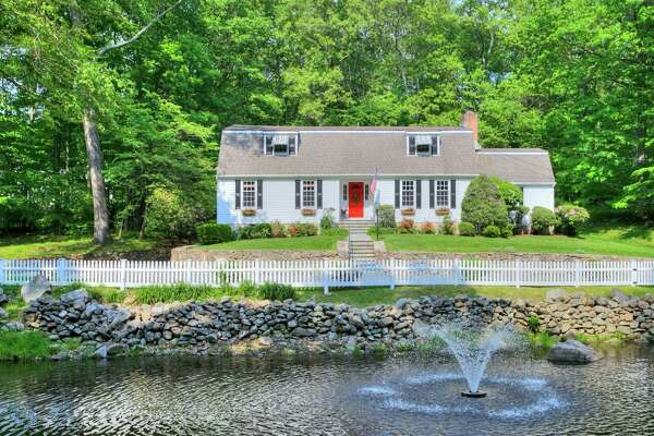 This New Canaan house located on Bittersweet Lane is on the market for $1,295,000.