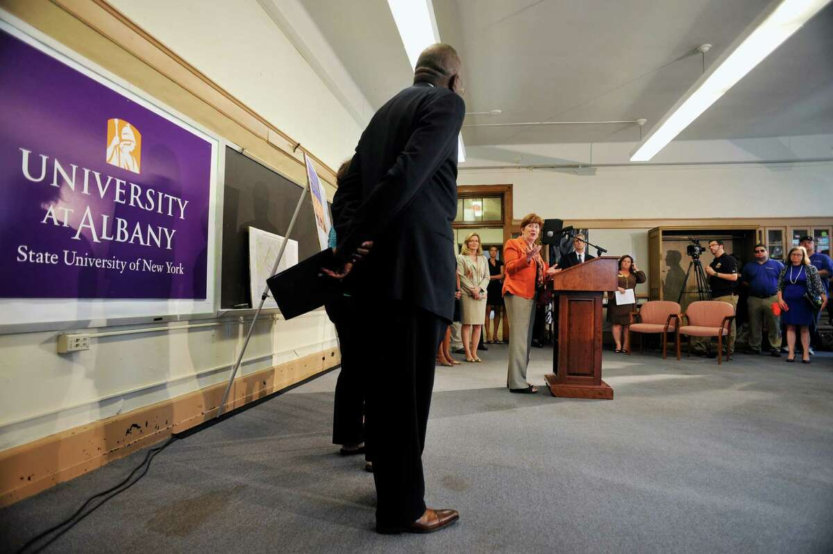 Albany Mayor Kathy Sheehan, at podium, addresses those gathered at the University at Albany downtown campus for a press conference to announce a joint study, conducted by the City of Albany and UAlbany to look at improving connections to the UAlbany downtown campus, on Monday, July 18, 2016, in Albany, N.Y. (Paul Buckowski / Times Union)