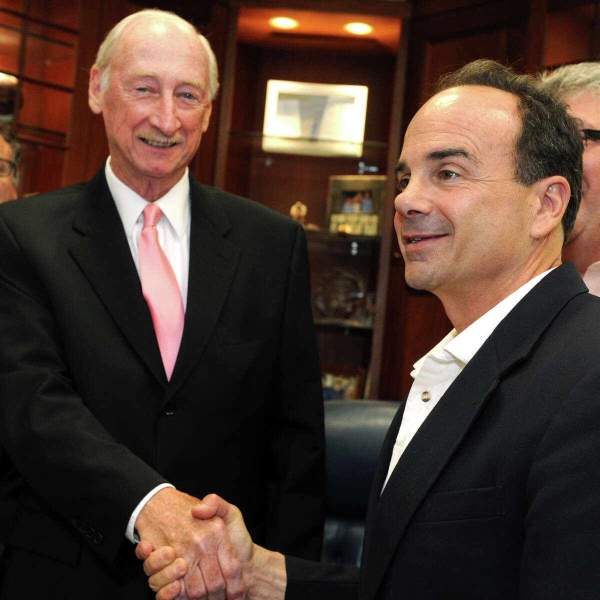 Mayor Joe Ganim, right, shakes hands with Thomas Gill, who has been chosen as the new economic development director for the City of Bridgeport, July 18, 2016.