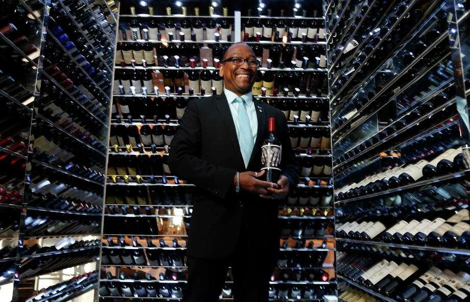 Morton's sommelier Michael Fogle touts his wine of choice, the 2012 Orin Swift's Papillon. Photo: Karen Warren, Staff / © 2016 Houston Chronicle