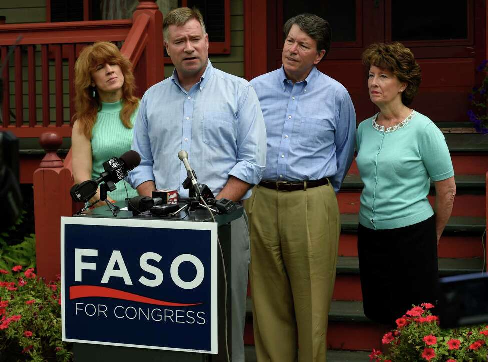 U.S. Rep. Chris Gibson, 19th CD, center, endorses John Faso, second from right, for his seat in Congress on Monday, July 18 2016, outside Gibson's home in Kinderhook, N.Y. Joining the Congressman and candidate are Mary Jo Gibson, left, and Mary Francis Faso, right. (Skip Dickstein/Times Union)