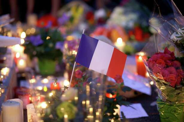 A French flag sits between flowers and candles at a makeshift memorial to commemorate the victims of an attack near the area where a truck mowed through revelers in Nice, France. Terrorists everywhere must be denied sanctuary and the means to launch such attacks. That means disrupting their funding sources and their tools of recruitment.