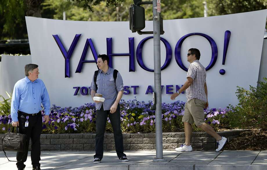 People walk in front of a Yahoo sign at the company's headquarters in Sunnyvale. Photo: Marcio Jose Sanchez, Associated Press