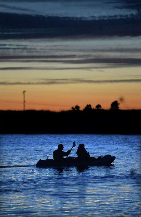 Visitors take an evening kayak trip after having dinner at the Garlic Brothers restaurant in Stockton, Calif. Photo: Doug Duran, MBR / East Bay Times