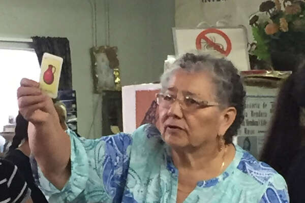 "Petra Mata, co-director  of Fuerza Unida, calls out ""El Cantarito"" during a lotería game last month."