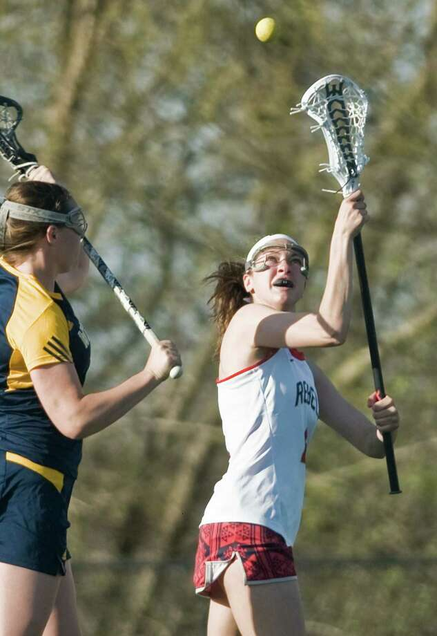 FILE PHOTO: New Fairfield High School's Bridget Zima tries to catch the loose ball in a game against Weston High School, played at New Fairfield. Thursday, April 21, 2016 Photo: Scott Mullin / For The / The News-Times Freelance