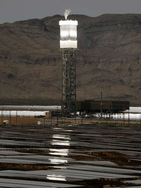 A solar receiver and boiler on top of a tower is reflected in heliostats at the Ivanpah Solar Electric Generating System in the Mojave Desert near Primm, Nev. Photo: Ethan Miller, Getty Images
